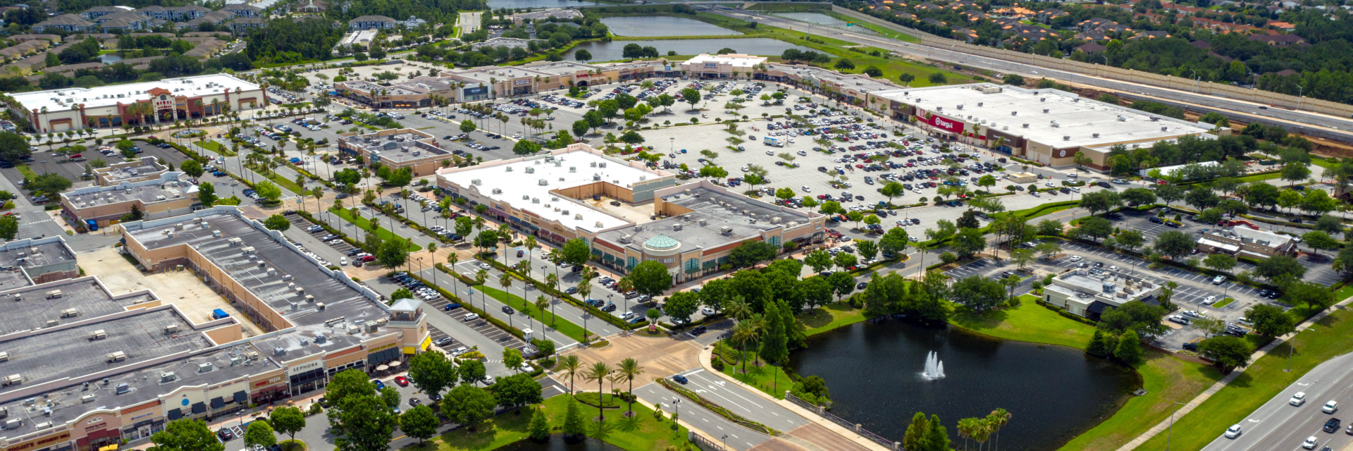 Aerial photo of a busy shopping center on a clear day in Orlando, Florida.