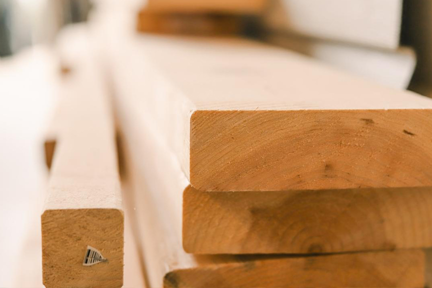 Focus on a stack of neatly cut lumber planks.