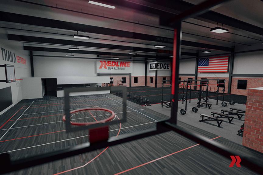Redline Athletics gym interior featuring a basketball court and training equipment.